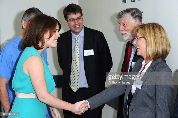 Princess Eugenie is greeted by Mary Fennelly and Tim Morley during a visit to Royal National Orthopaedic Hospital on April 2 2014 in Stanmore Greater...