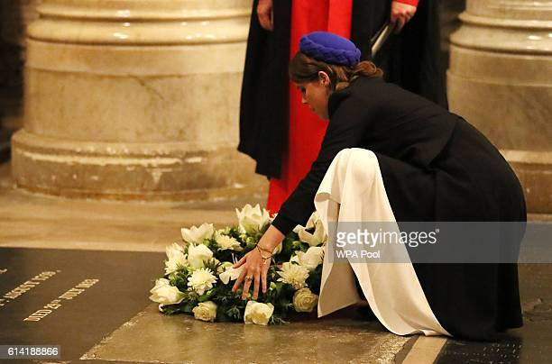 Princess Eugenie lays a wreath during a service to commemorate the work of William Wilberforce and mark the United Kingdom's commitment to combat...