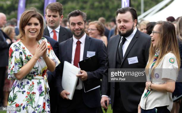 Princess Eugenie left laughs as she meets actor John Bradley second right during a day of DofE presentations at Buckingham Palace on May 24 2018 in...
