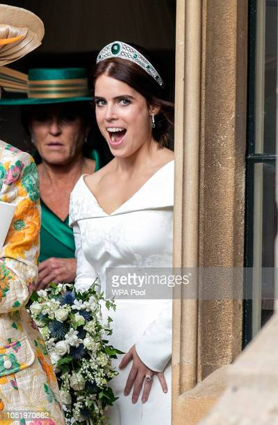 Princess Eugenie makes her way to their car as she leaves Windsor Castle after their wedding for an evening reception at Royal Lodge on October 12...