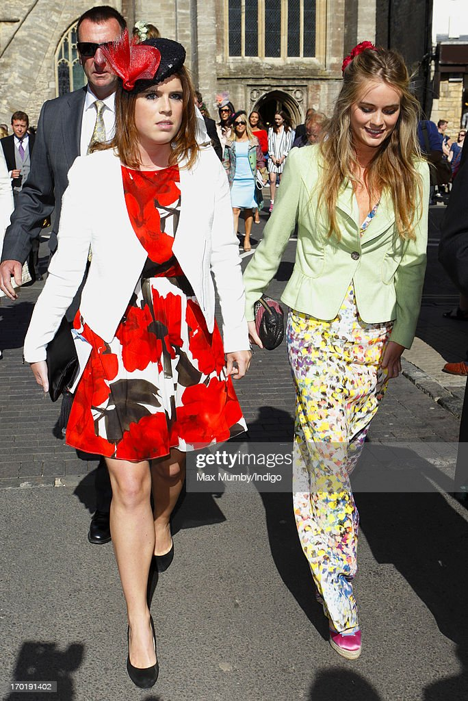 Princess Eugenie of York and Cressida Bonas attend the wedding of Lady Natasha Rufus Isaacs and Rupert Finch at the church of St John the Baptist on June 8, 2013 in Cirencester, England.
