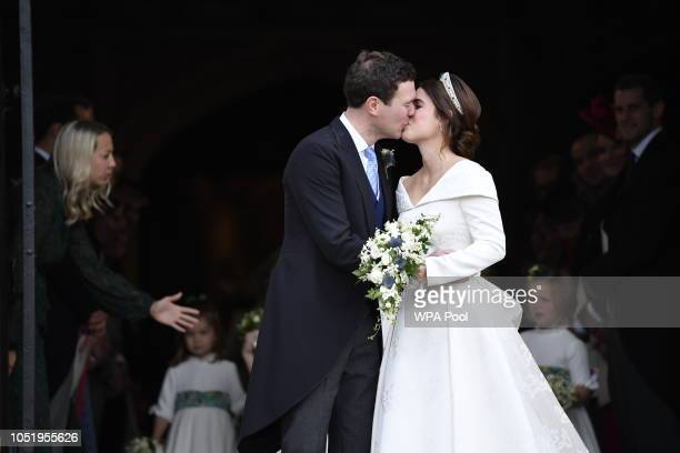 Princess Eugenie of York and her husband Jack Brooksbank kiss on the steps of St George's Chapel after their wedding at St George's Chapel on October...