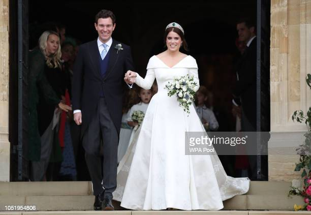 Princess Eugenie of York and her husband Jack Brooksbank on the steps of St George's Chapel after their wedding at St. George's Chapel on October 12,...