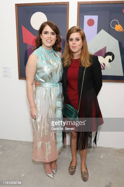 Princess Eugenie of York and HRH Princess Beatrice of York at the Animal Ball Art Show Private Viewing, presented by Elephant Family on May 22, 2019...