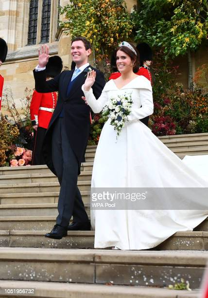 Princess Eugenie of York and husband Jack Brooksbank leave St George's Chapel in Windsor Castle following their wedding on October 12, 2018 in...