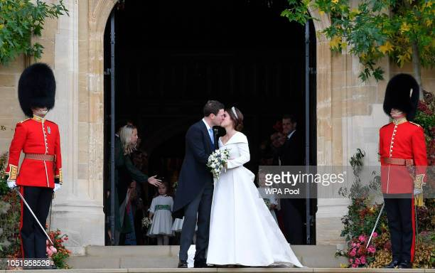 Princess Eugenie of York and Jack Brooksbank kiss as they leave after their wedding at St George's Chapel in Windsor Castle on October 12 2018 in...