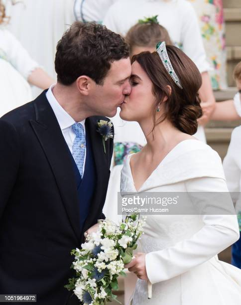 Princess Eugenie of York and Jack Brooksbank kiss as they leave St George's Chapel in Windsor Castle following their wedding at St. George's Chapel...