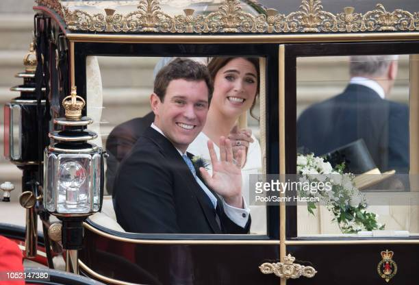 Princess Eugenie of York and Jack Brooksbank leave St George's Chapel in Windsor Castle following their wedding at St. George's Chapel on October 12,...