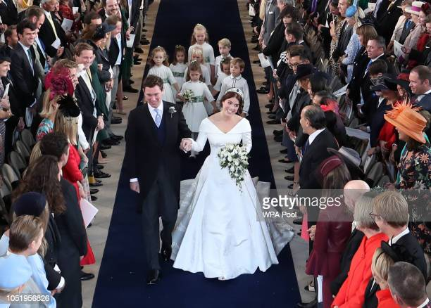 Princess Eugenie of York and Jack Brooksbank walk down the aisle following their marriage at St George's Chapel in Windsor Castle on October 12 2018...