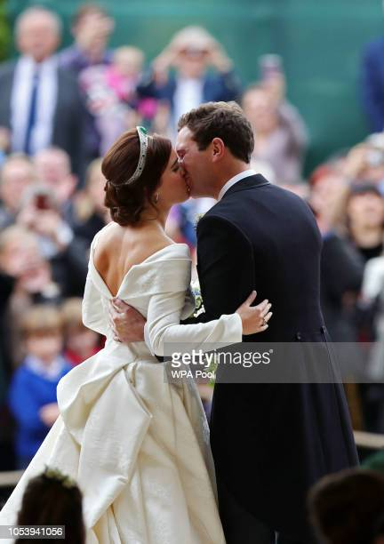 Princess Eugenie of York and Mr Jack Brooksbank kiss after they were wed at St George's Chapel on October 12 2018 in Windsor England