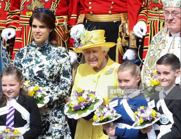 Princess Eugenie of York and Queen Elizabeth II attend the traditional Royal Maundy Service at St George's Chapel on April 18 2019 in Windsor England