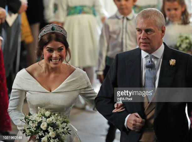 Princess Eugenie of York arrives with her father Prince Andrew Duke of York ahead of her wedding to Mr Jack Brooksbank at St George's Chapel on...