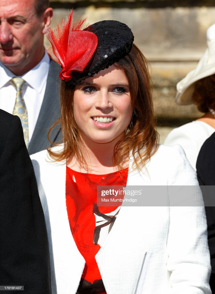 Princess Eugenie of York attends the wedding of Lady Natasha Rufus Isaacs and Rupert Finch at the church of St John the Baptist on June 8, 2013 in Cirencester, England.