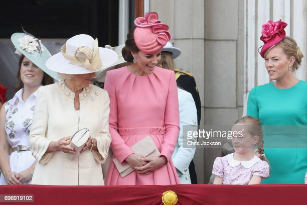 Princess Eugenie of York Camilla Duchess of Cornwall Catherine Duchess of Cambridge and Autumn Phillips look out from the balcony of Buckingham...