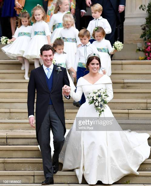 Princess Eugenie of York of York and her husband Jack Brooksbank leave after their wedding at St George's Chapel in Windsor Castle on October 12 2018...