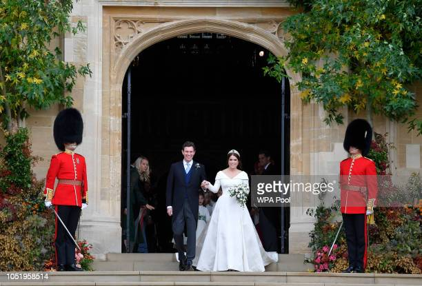 Princess Eugenie of York of York and her husband Jack Brooksbank leave after their wedding at St George's Chapel in Windsor Castle on October 12,...
