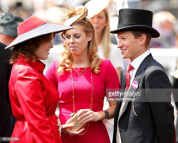 Princess Eugenie of York Princess Beatrice of York and Dave Clark attend Day 5 of Royal Ascot at Ascot Racecourse on June 21 2014 in Ascot England