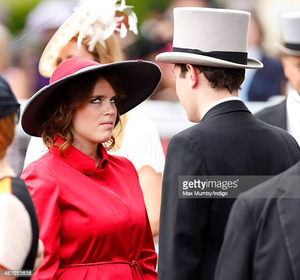 Princess Eugenie of York rolls her eyes as she talks with Jack Brooksbank on Day 5 of Royal Ascot at Ascot Racecourse on June 21 2014 in Ascot England