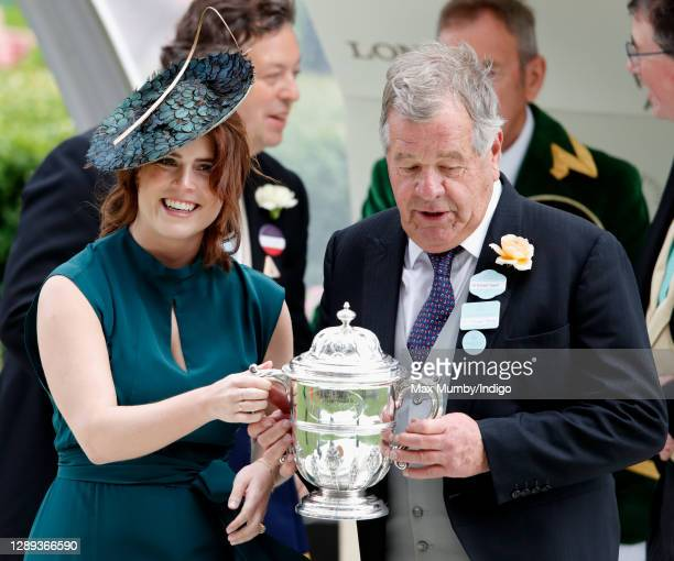 Princess Eugenie presents Sir Michael Stoute with the winning trainer's trophy after 'Sangarius' won the Hampton Court Stakes on day three, Ladies...