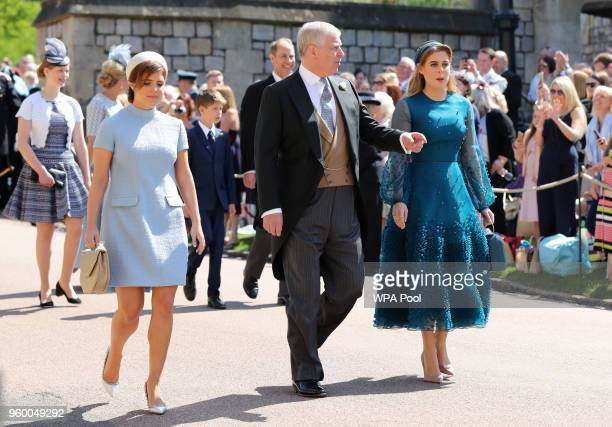 Princess Eugenie Prince Andrew Duke of York and Princess Beatrice arrive at St George's Chapel at Windsor Castle before the wedding of Prince Harry...