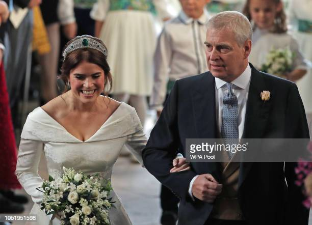 Princess Eugenie walks down the aisle with her father Prince Andrew the Duke of York for her wedding to Jack Brooksbank at St George's Chapel in...