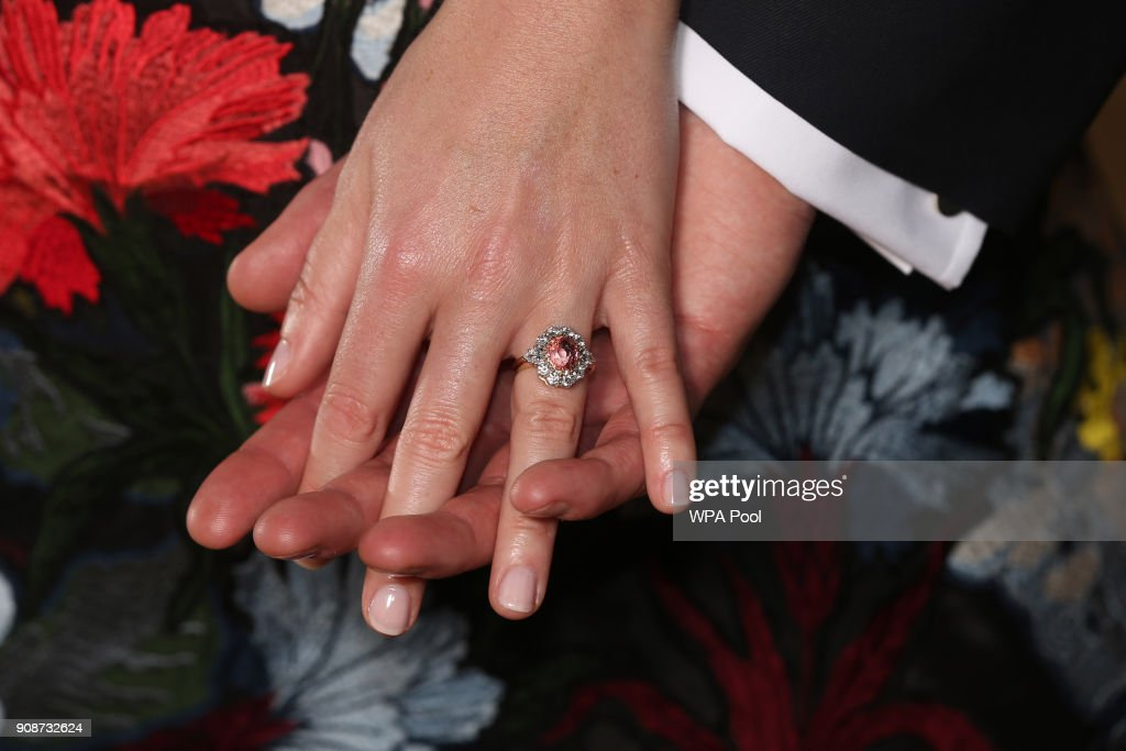 Princess Eugenie wears a ring containing a padparadscha sapphire surrounded by diamonds as she poses with Jack Brooksbank in the Picture Gallery at Buckingham Palace after they announced their engagement. Princess Eugenie wears a dress by Erdem, shoes by Jimmy Choo and a ring containing a padparadscha sapphire surrounded by diamonds on January 22, 2018 in London, England.. They are to marry at St George's Chapel in Windsor Castle in the autumn this year.