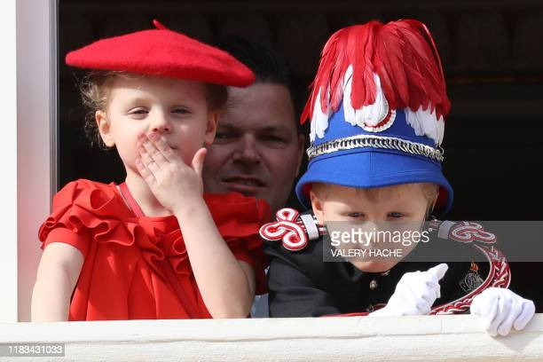 Princess Gabriella and Prince Jacques wave at the crowd from a balcony of Monaco Palace during the celebrations marking Monaco's National Day in...