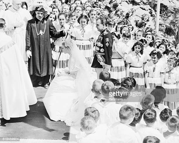 Princess Grace kneels at the altar during benediction at the Chapel of Sainte Devote, where she and Prince Rainier stopped immediately following...