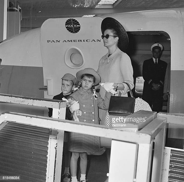Princess Grace of Monaco and her children Albert and Caroline who hugs dolls board a Parisbound plane at Idlewood on their way home after a sixweek...