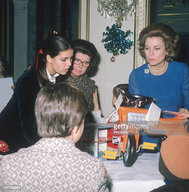 Princess Grace of Monaco and her daughter Princess Caroline handing out Christmas presents to the children on Monaco in 1971