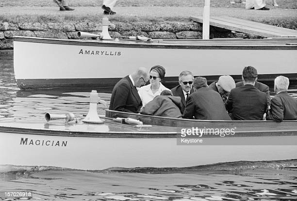 Princess Grace of Monaco and her husband Prince Rainier III in a spectators' launch on the Thames at Henley Royal Regatta, Henley-on-Thames,...