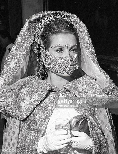 Princess Grace of Monaco attends a masked ball at Ca' Rezzonico palazzo in Venice