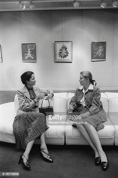 Princess Grace of Monaco chats with AnneAymone wife of French president Valery Giscard d'Estaing at the Galerie Drouant in Paris Princess Grace is...
