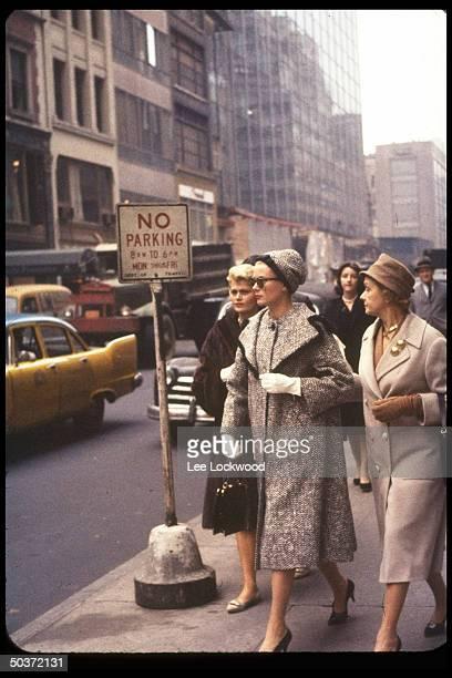 Princess Grace of Monaco , formerly actress Grace Kelly, strolls along street with mother, Mrs. John B. Kelly .