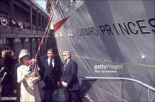 Princess Grace of Monaco launches a bottle of champagne to christen the Cunard Princess Cunard Lines latest passenger ship New York New York March 30...