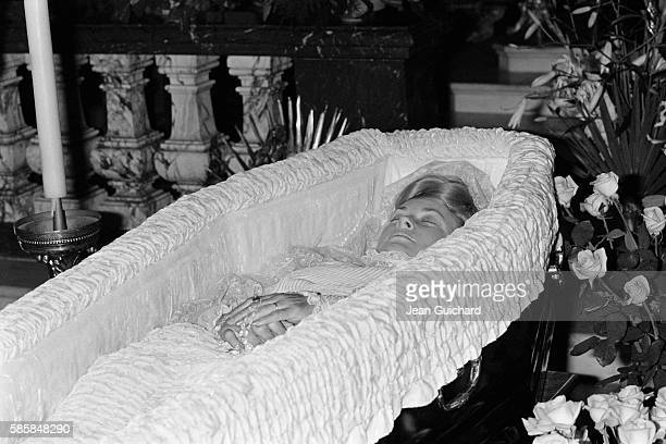 Princess Grace of Monaco lying in state in open wooden coffin after her death in a car crash on September 14