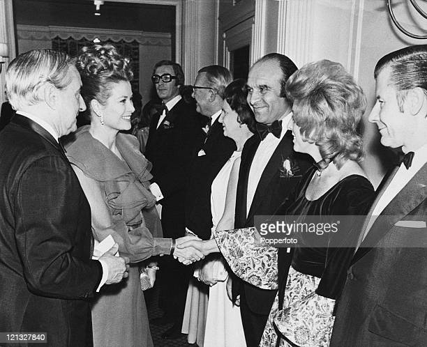 Princess Grace of Monaco meeting a line up of people taking part in a Variety Club charity ball in Leeds 27th October 1972 Michael Caine is at the...