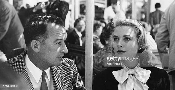 Princess Grace of Monaco pictured with the Mayor of Cannes during a luncheon at the Hotel Martinez during the Cannes Film Festival May 1955