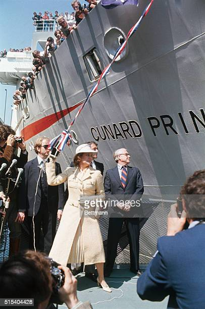 Princess Grace of Monaco rears back to break bottle of champagne against luxury liner Cunard Princess during christening ceremony 3/30 The...