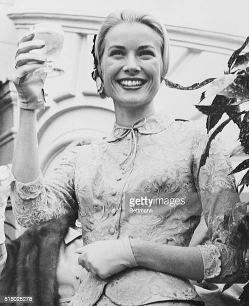 Princess Grace Toasts Wedding Guests Monte Carlo Monaco Just brimming over with happiness Princess Grace holds up her glass to toast the guests at...
