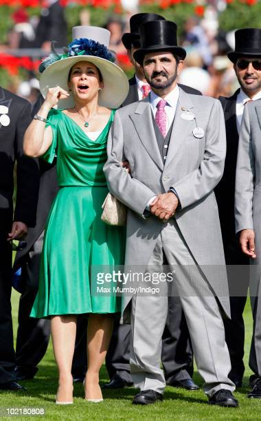 Princess Haya Bint Al Hussein and HH Sheikh Mohammed Bin Rashid Al Maktoum watch the racing as they attend Royal Ascot Ladies Day at Ascot Racecourse...