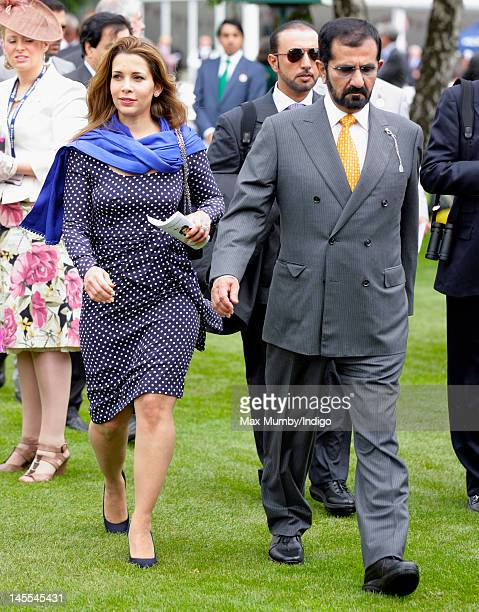 Princess Haya Bint Al Hussein and Sheikh Mohammed bin Rashid Al Maktoum attend Ladies Day at the Investec Derby Festival horse racing meeting at...