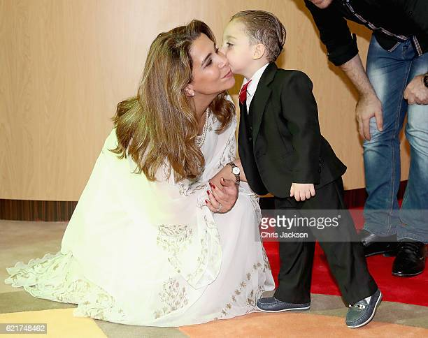 Princess Haya Bint Al Hussein greets a young Syrian boy called Mohamad Helly on day 3 of a Royal tour of the United Arab Emirates at Al Jalila...