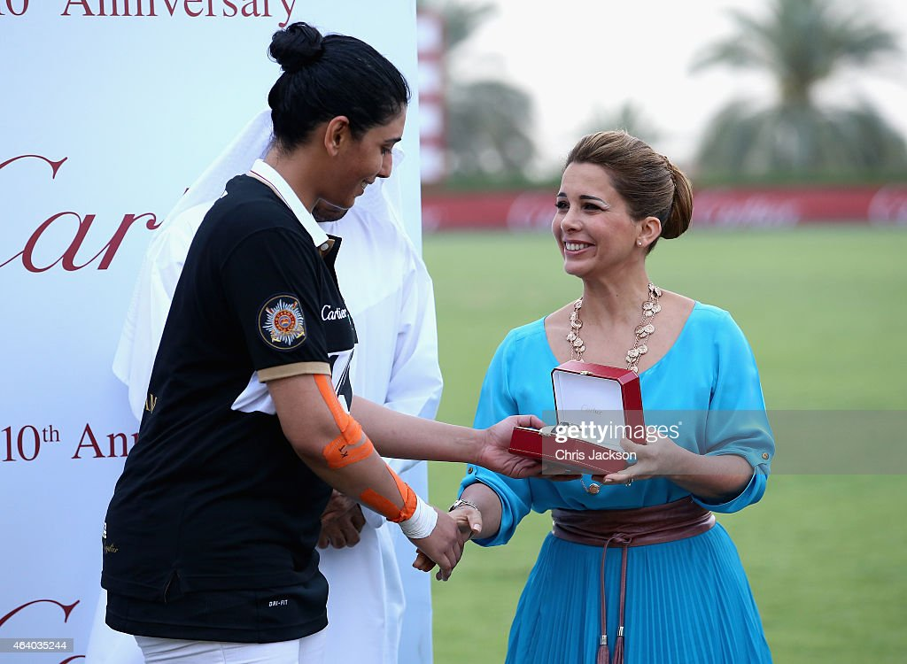 Princess Haya Bint Al Hussein presents a watch to HH Sheikha Maitha during the presentations on the final day of the Cartier International Dubai Polo Challenge 10th edition at Desert Palm Hotel on February 21, 2015 in Dubai, United Arab Emirates. The event takes place under the patronage of HRH Princess Haya Bint Al Hussein, Wife of HH Sheikh Mohammed Bin Rashid Al Maktoum, Vice-President and Prime Minister of the UAE and Ruler of Dubai. The Cartier International Dubai Polo Challenge is one of the most prestigious happenings in Dubai's sporting and social calendar. On this occasion Cartier launched their latest watch creation Cle De Cartier.