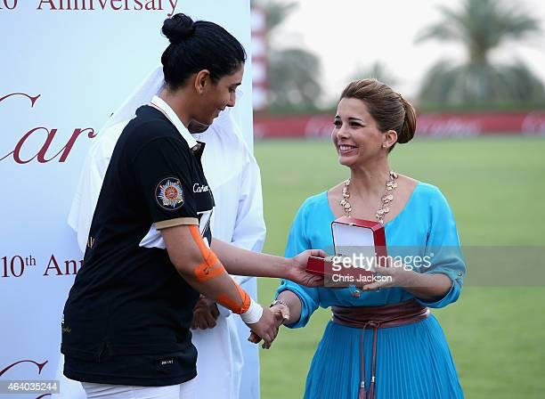 Princess Haya Bint Al Hussein presents a watch to HH Sheikha Maitha during the presentations on the final day of the Cartier International Dubai Polo...