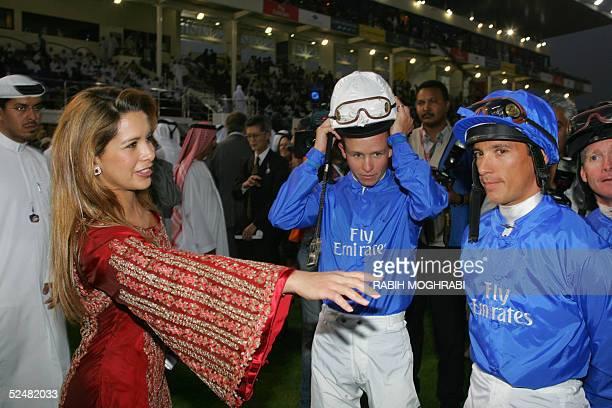 Princess Haya of Jordan and wife of Sheikh Mohammed bin Rached Al Maktoum speaks to jockeys Lanfranco Dettori and Kerrin McEvoy during the Dubai...