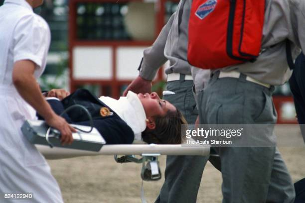 Princess Haya of Jordan is taken off by a stretcher after falling while competing in the Equestrian Individual Jumping during the 12th Asian Games...
