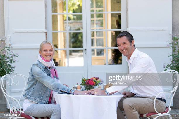 Princess Helene Of Yugoslavia and Stanislas Fougeron pose together in the family castle of Villeprevost On September 7 2018 in TillaylePeneux France...