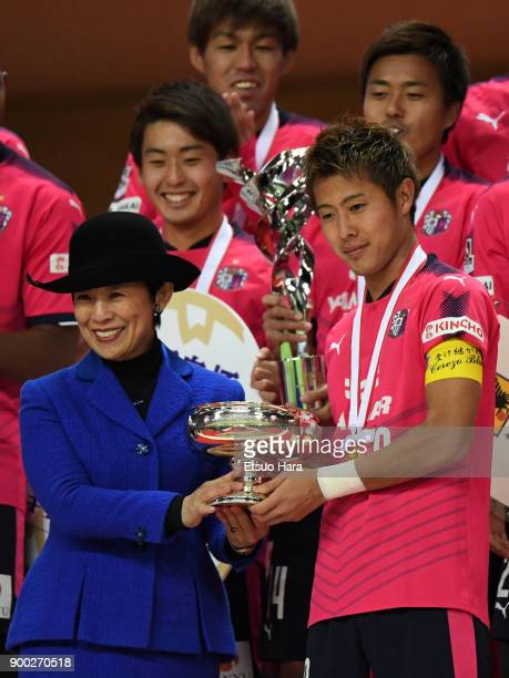 Princess Hisako Takamado and Yoichiro Kakitani of Cerezo Osaka pose with the trophy during the medal ceremony after the 97th All Japan Football...