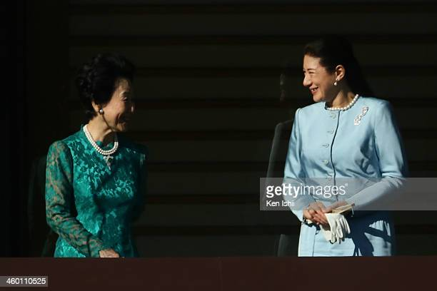 Princess Hitachi speaks with Crown Princess Masako during celebrations for the New Year on the veranda of the Imperial Palace on January 2 2014 in...